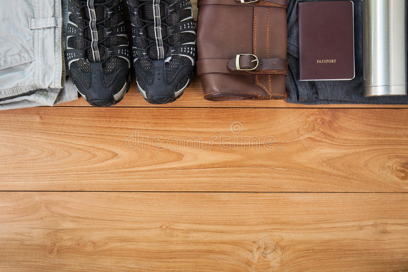 Packed suitcase of vacation items, top view stock photography
