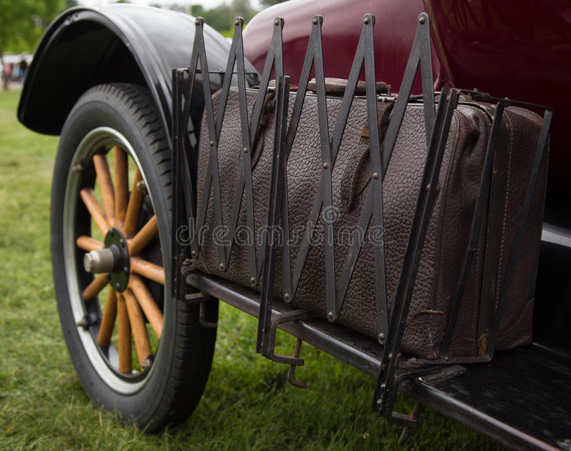 Packed for Travel. Redding, California, USA- April 27, 2014: A classic car sports an old leather suitcase ready for the road at the Kool April Nights auto show stock photo