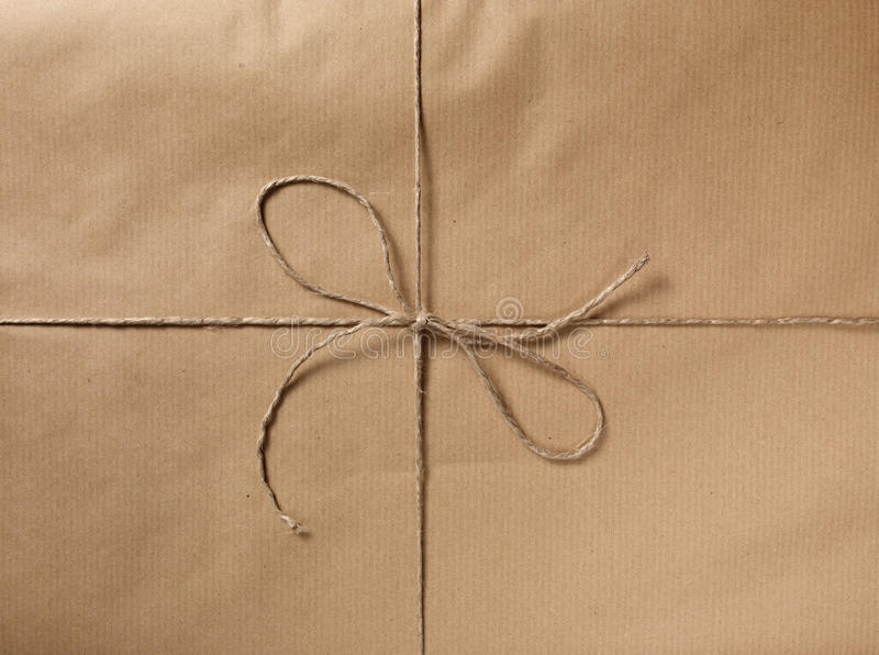 Packet with bow. A packet closed with a string and bow stock photos