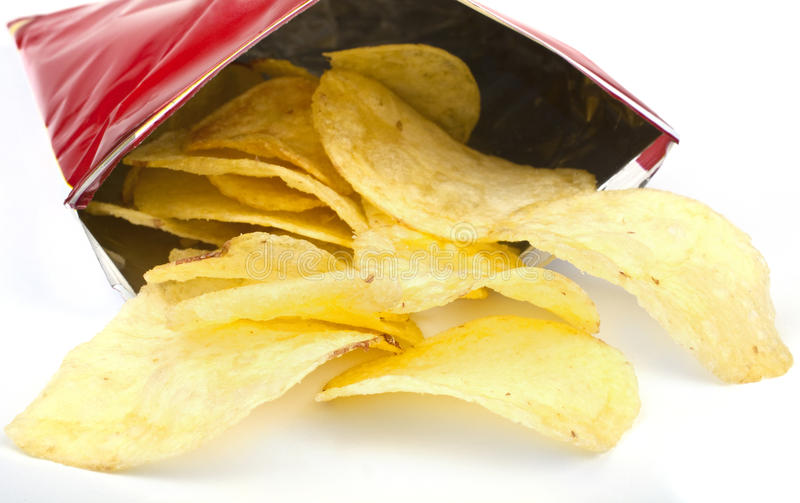 Packet of Crisps. Crisps/chips falling out of the packet royalty free stock photos