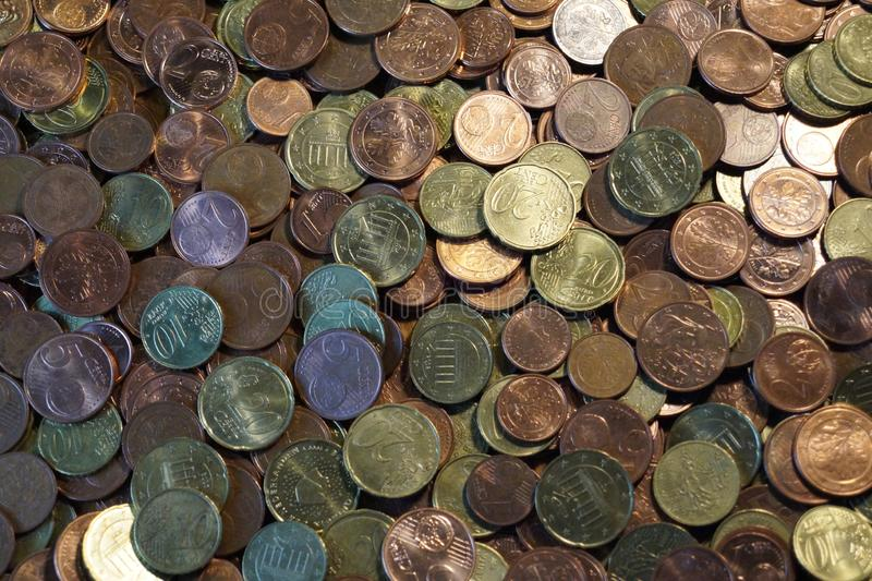 A packet of euro cent coins. A whole stack and packet of different euro cent coins stock images