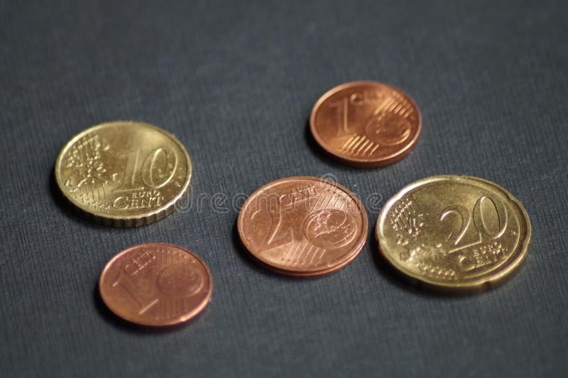 A packet of euro cent coins. A whole stack and packet of different euro cent coins royalty free stock image