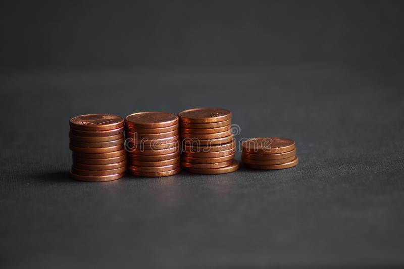 A packet of euro cent coins. A whole stack and packet of different euro cent coins stock photography