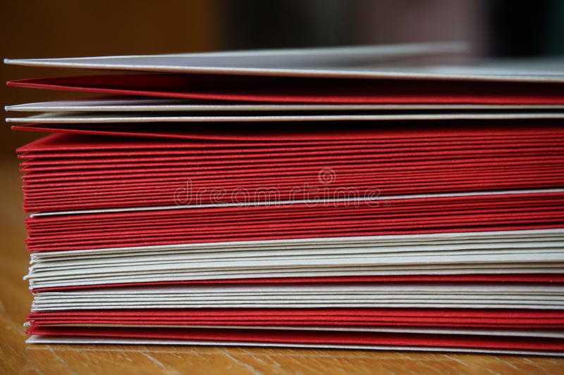 Packet of red and silver (pearly) envelopes. Prepared for the written announcement note stock photo