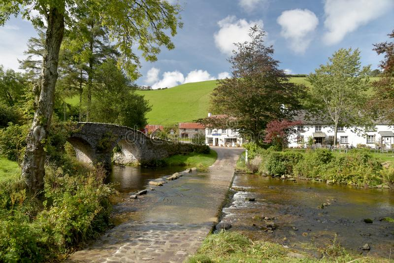 Packhorse bridge and ford at Malmsmead, Exmoor, North Devon. Picturesque packhorse bridge and ford through Badgworthy Water at Malmsmead, Exmoor, North Devon royalty free stock images