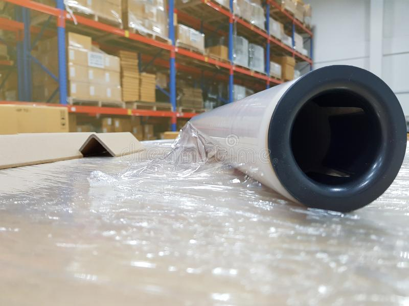 Packing accessories at workplace of industry,Stretch Wrap Industrial Strength,Roll of wrapping plastic stretch. Film,Close-up,Shipping concept royalty free stock image