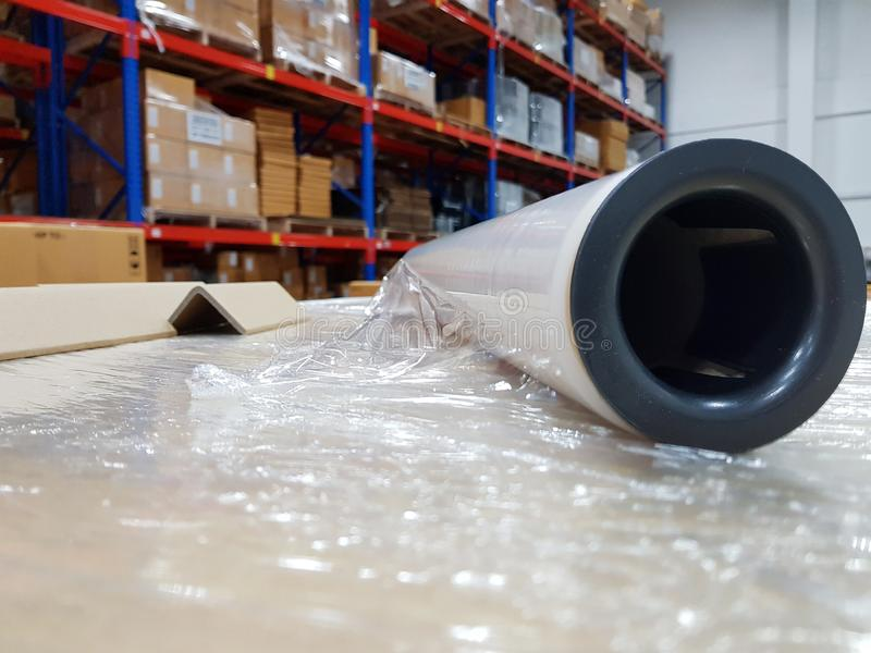 Packing accessories at workplace of industry,Stretch Wrap Industrial Strength,Roll of wrapping plastic stretch. Film,Close-up,Shipping concept stock photo