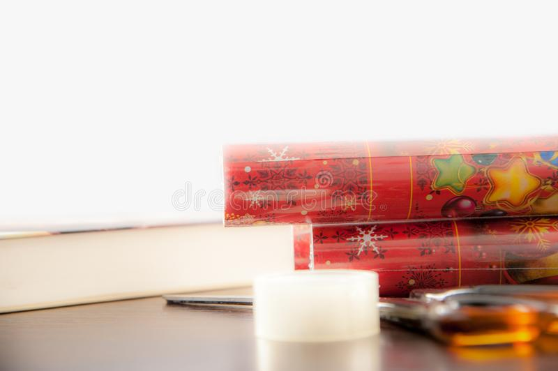 Packing christmas gifts, table with presents during their packing before giving a loved one.  stock image