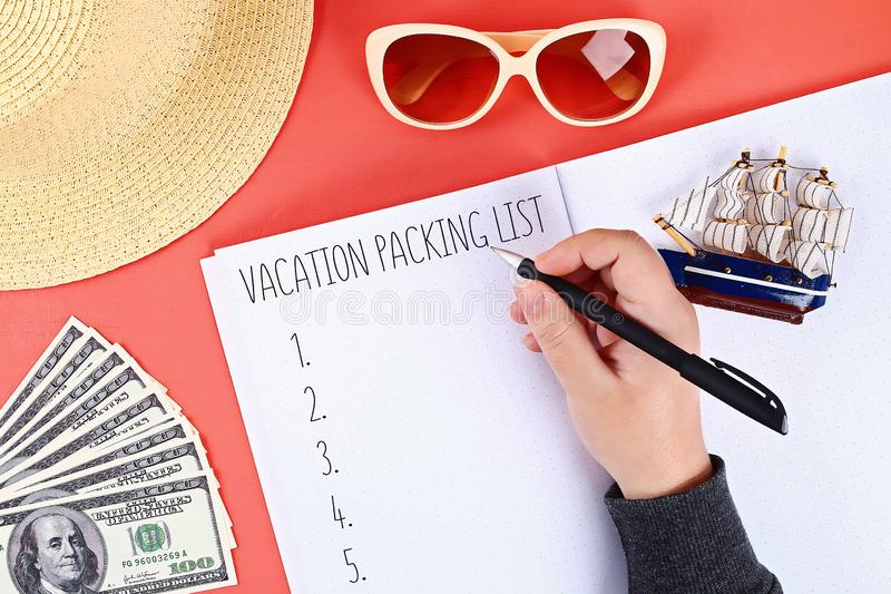 Packing list for summer vacation on sheet of notebook. Vacation travel concept. Packing list for summer vacation on a sheet of notebook. Vacation travel concept stock photography