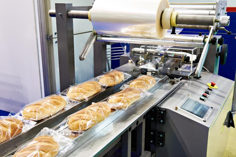 Packing machine for loaves bread royalty free stock photo