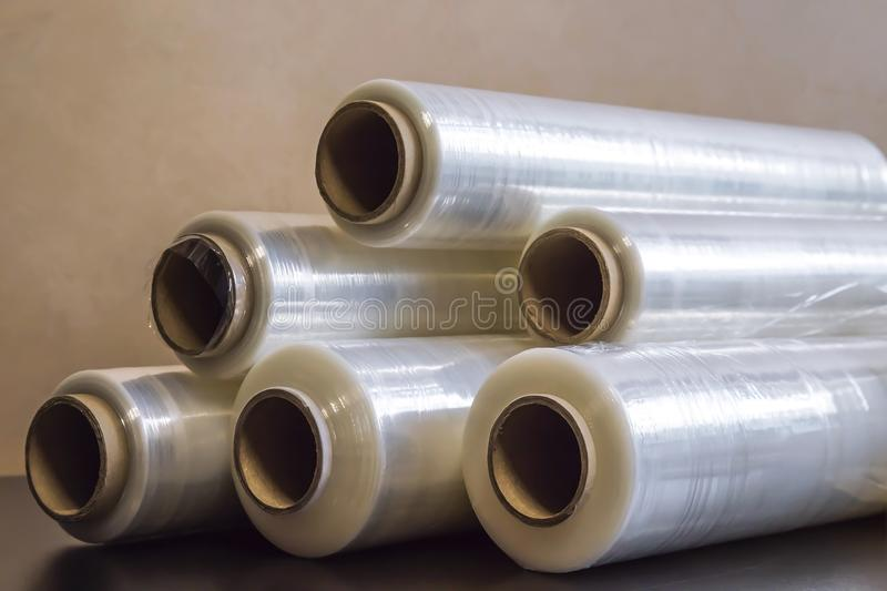 Packing material. Many rolls of stretch film are white transparent. Polymer product for wrapping. Packing material. Many rolls of stretch film are white stock photos