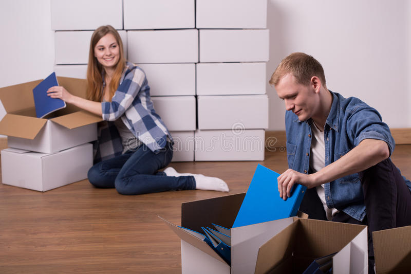 Packing notes into the boxes royalty free stock photo