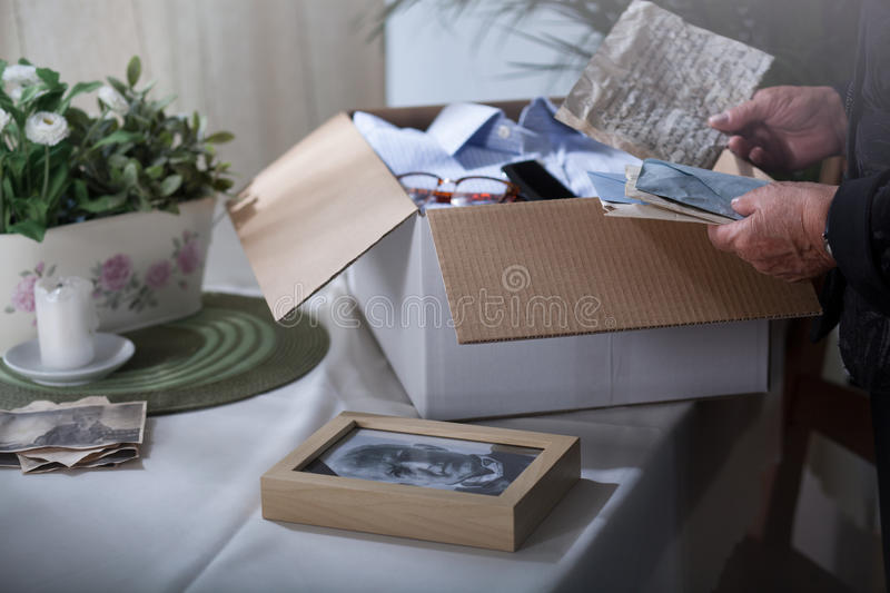 Packing remembrances after dead husband royalty free stock photo