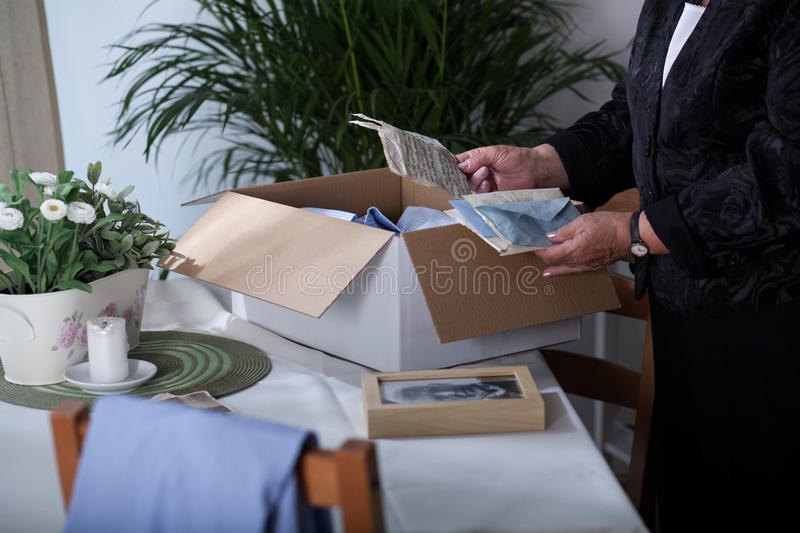 Packing souvenirs after dead husband stock photo