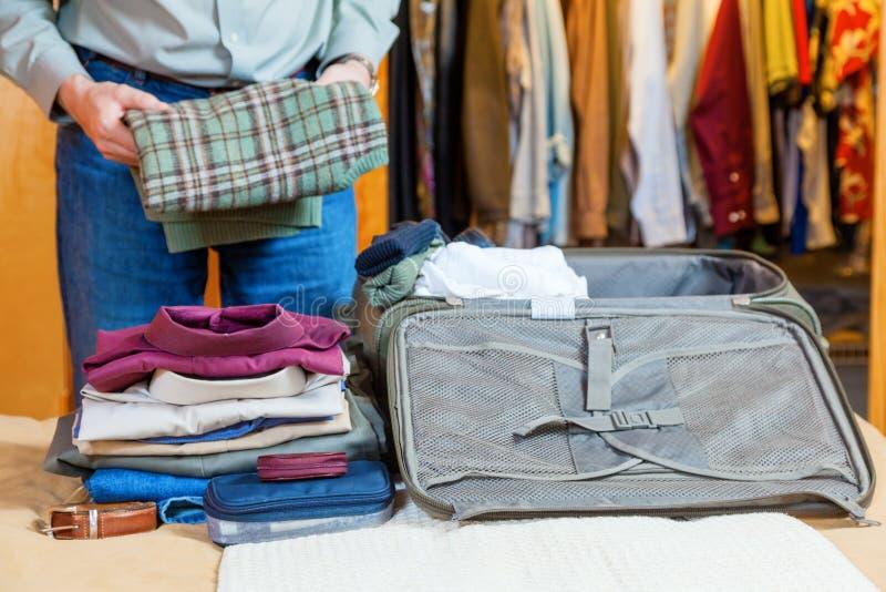 Packing suitcase stock image