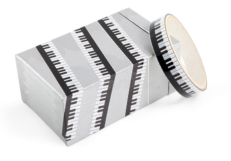Packing tape with print. Masking tape for gift wrapping. Decorative adhesive tape for packing gifts. Piano keys print. stock photo