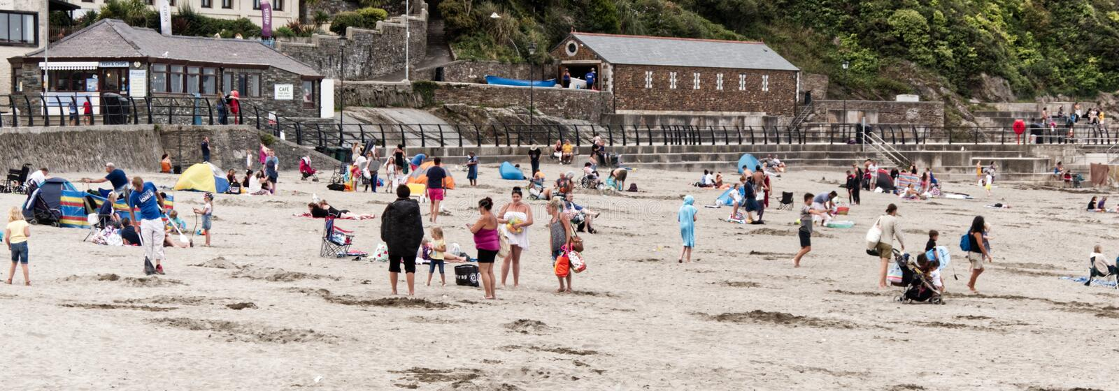 Packing up from a bank holiday at the beach. End of the bank holiday in the UK, people slowly packing up and leaving the beach at Looe, Cornwall, after the sun royalty free stock photos