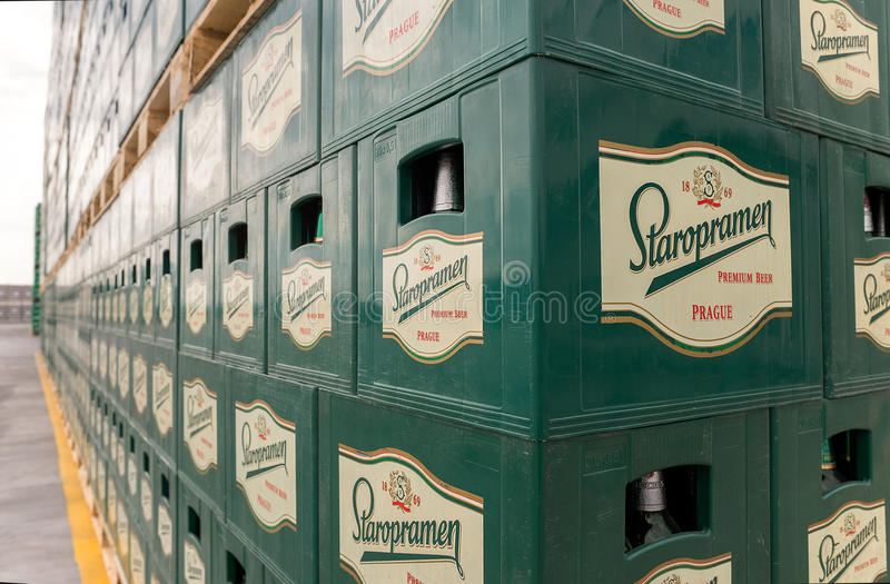 Packs of bottled beer in an outdoor storage lot. Packs with bottles Staropramen beer are seen in the Molson Coors Kamenitza brewery storage lot, April 28, 2015 stock images