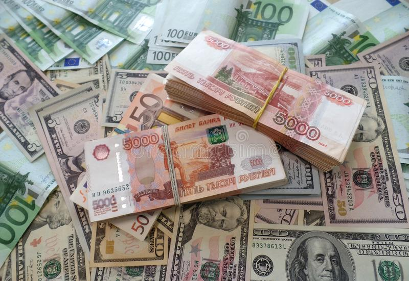 Packs million of Russian rubles with dollars and euro stock photography