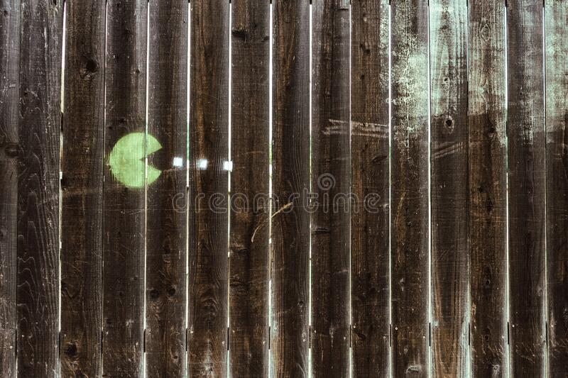 Pacman drawing on wooden fence stock images