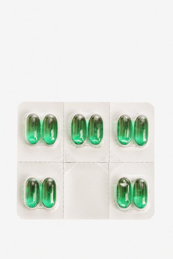 Pacote de comprimidos da cápsula. Isolado fotos de stock royalty free