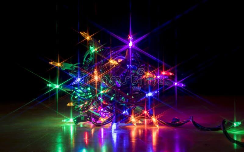 Pacote de incandescência colorido de luzes de Natal fotografia de stock