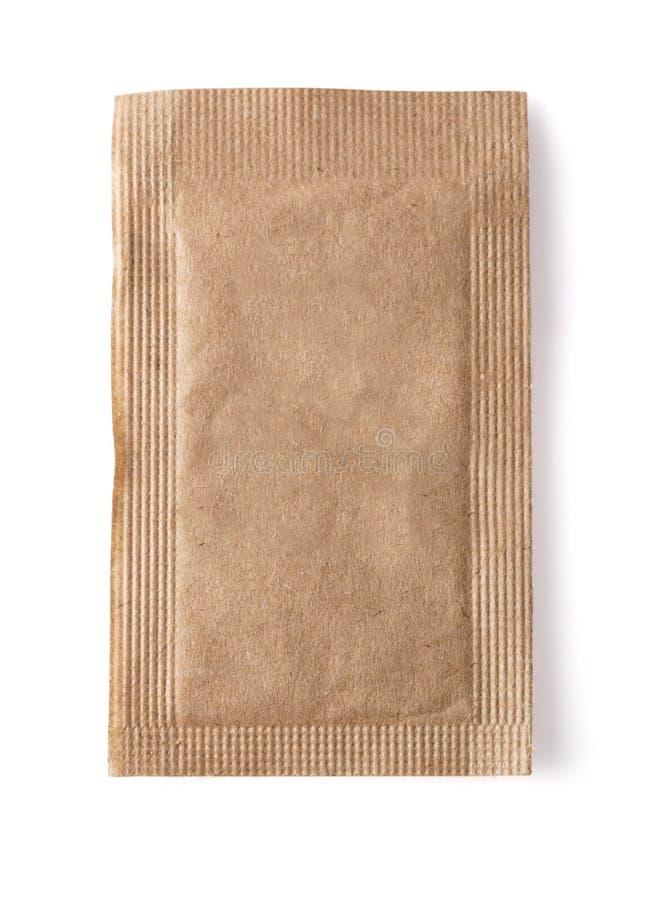 Pacote do açúcar mascavado fotografia de stock