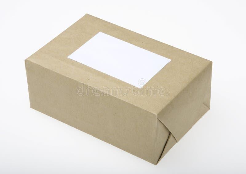 Pacote envolvido no papel de Brown fotografia de stock