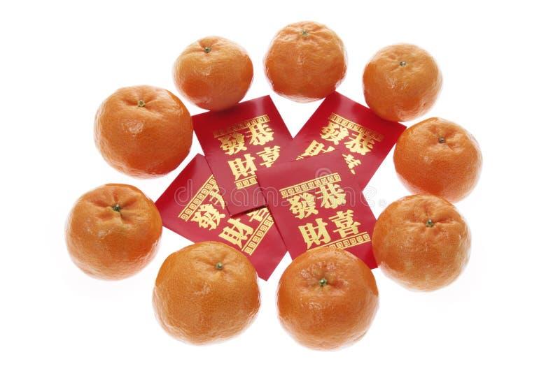 Pacotes e os mandarino vermelhos fotos de stock royalty free