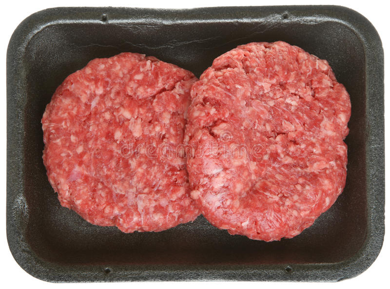 Paczka Surowi wołowina hamburgery, paszteciki lub zdjęcia stock