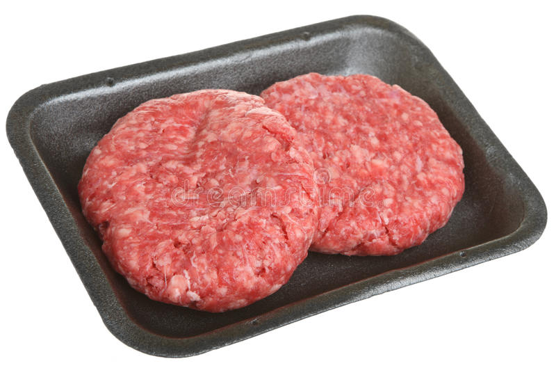 Paczka Surowi wołowina hamburgery, paszteciki lub obraz royalty free