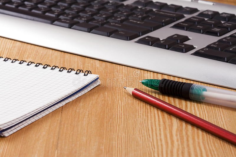 Pad, keyboard and pens stock photo