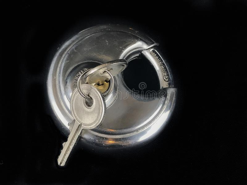 Pad Locks and Keys. A Stainless Steel pad lock and keys on a black backdrop royalty free stock images