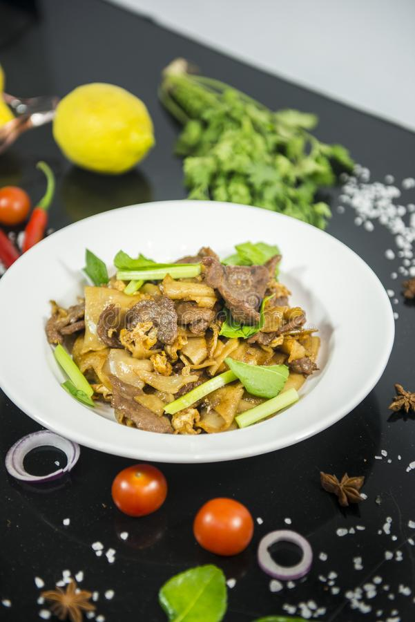 Pad se ew, stir fried flat rice noodle. With oyster sauce stock image