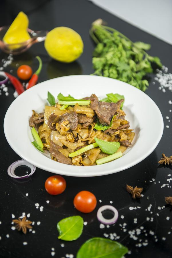 Pad se ew, stir fried flat rice noodle. With oyster sauce royalty free stock photo