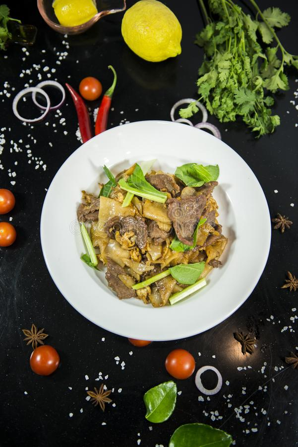 Pad se ew, stir fried flat rice noodle. With oyster sauce stock photos