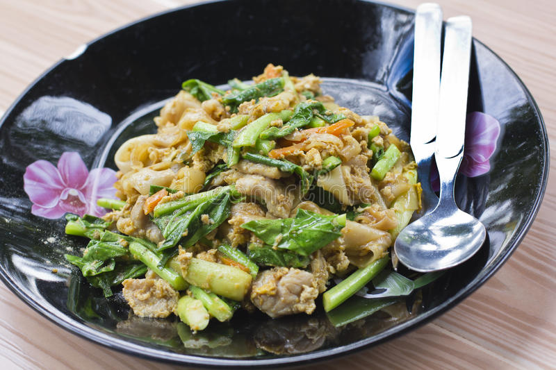 Pad See Ew. Thai fried noodle with pork royalty free stock image