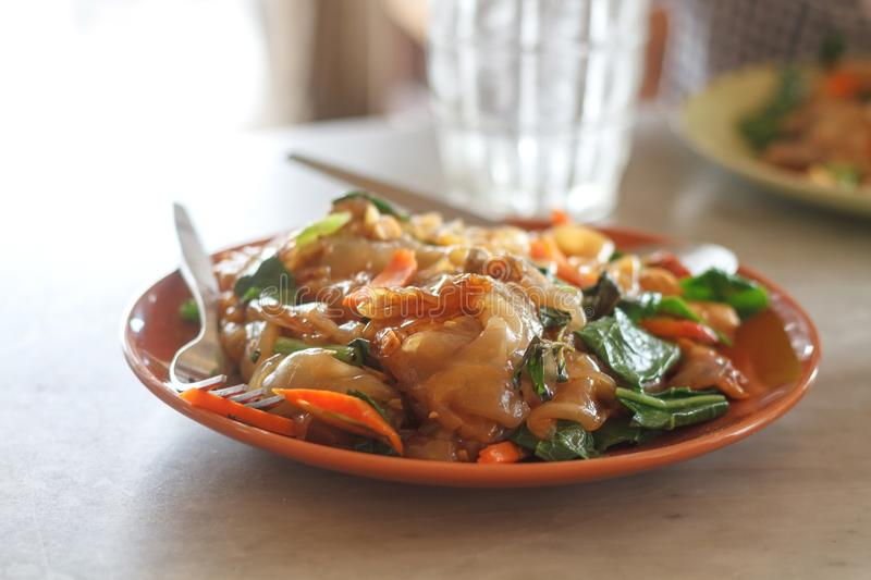 Pad See Ew. Stir Fried Fresh Rice Flour Noodles In Black Soy Sauce stock photography