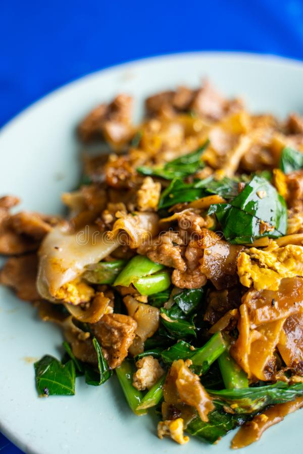Pad See Ew stir fried noodle with black soy sauce. Thai food royalty free stock photos