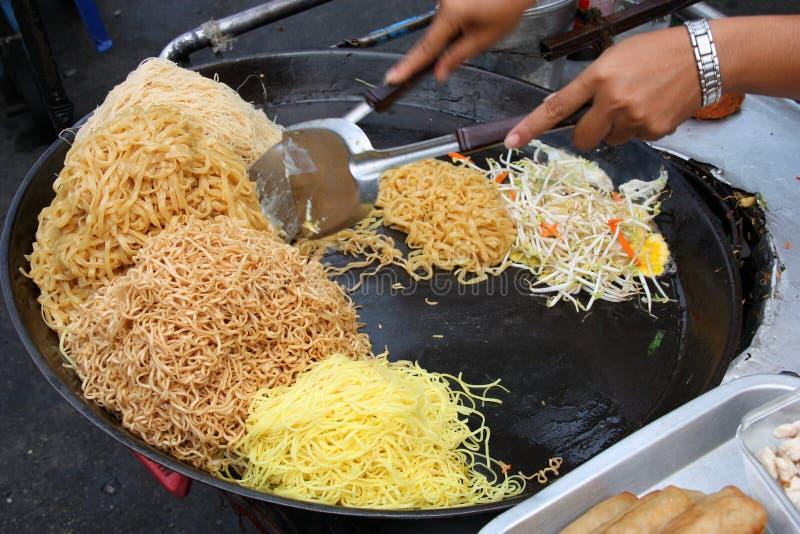 Pad thai. Preparing pad thai at a street hawker mobile restaurant in Bangkok, Thailand. Fried noodle royalty free stock image