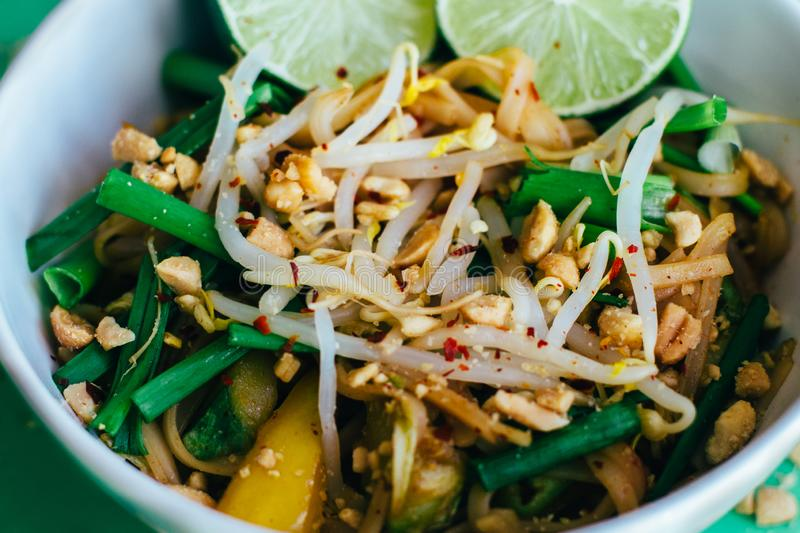 Pad thai close up in white plate. Pad thai close up. White plate stock images
