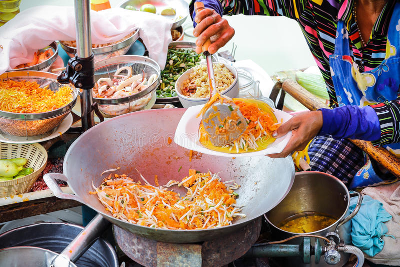 Pad thai. Cooking on the boat in Amphawa floating market stock photography