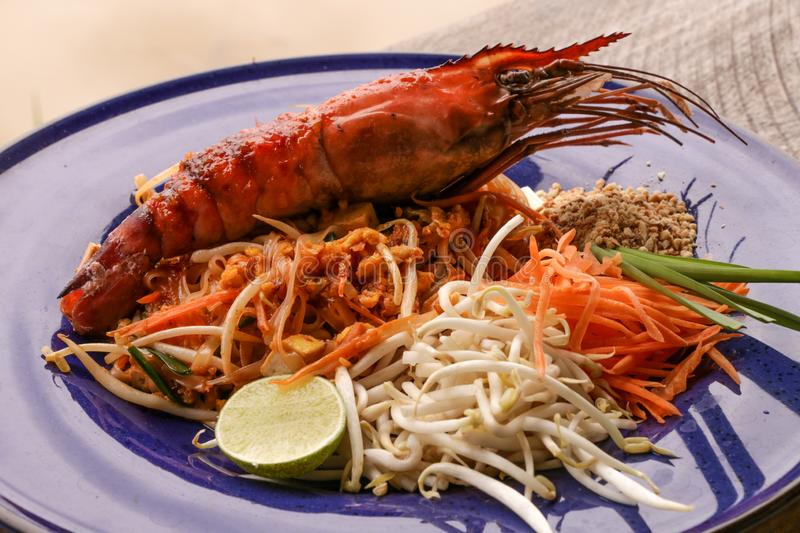 Hot Pad thai with shrimp on wooden table. Pad thai so deliciousclose up stock photography