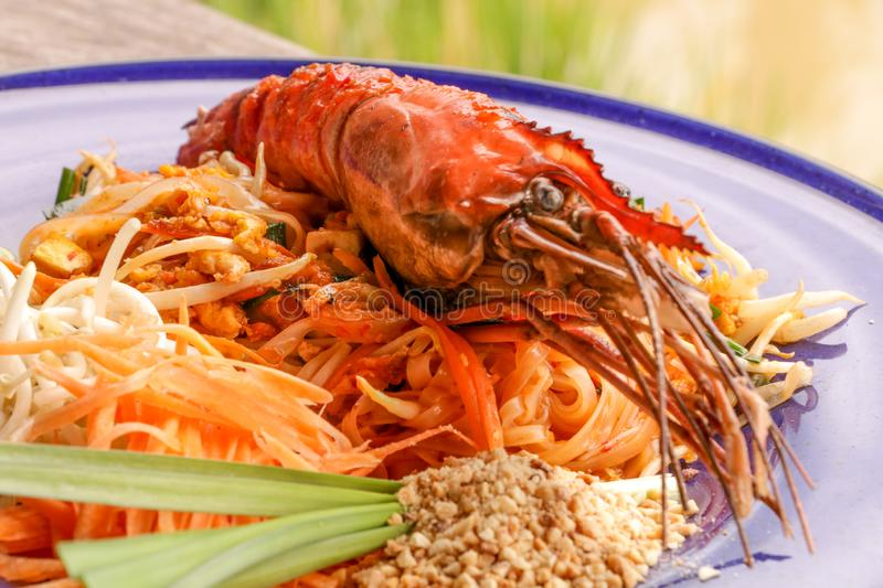Hot Pad thai with shrimp on wooden table. Pad thai so deliciousclose up royalty free stock photography