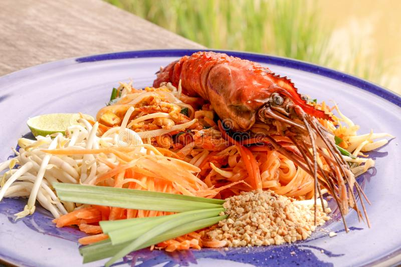 Hot Pad thai with shrimp on wooden table. Pad thai so deliciousclose up stock photos