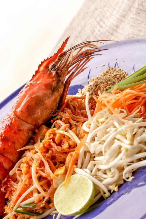 Hot Pad thai with shrimp on wooden table. Pad thai so deliciousclose up royalty free stock photo