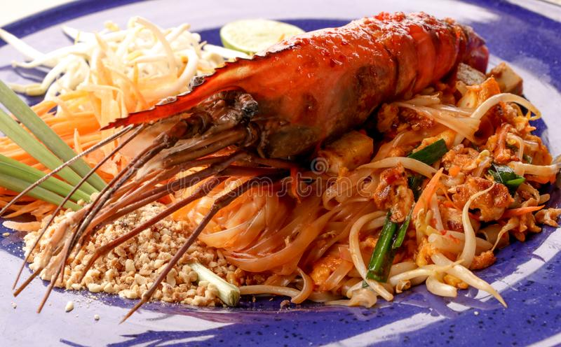 Hot Pad thai with shrimp on wooden table. Pad thai so deliciousclose up stock images