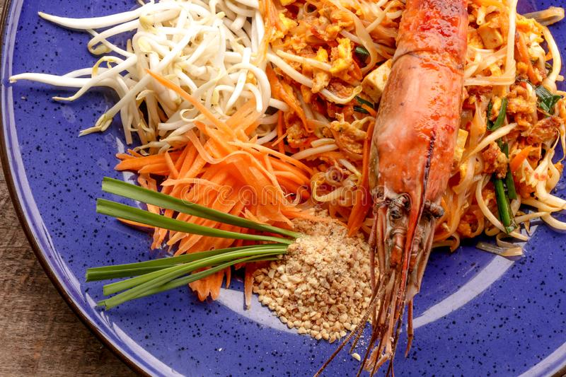 Hot Pad thai with shrimp on wooden table. Pad thai so deliciousclose up stock image