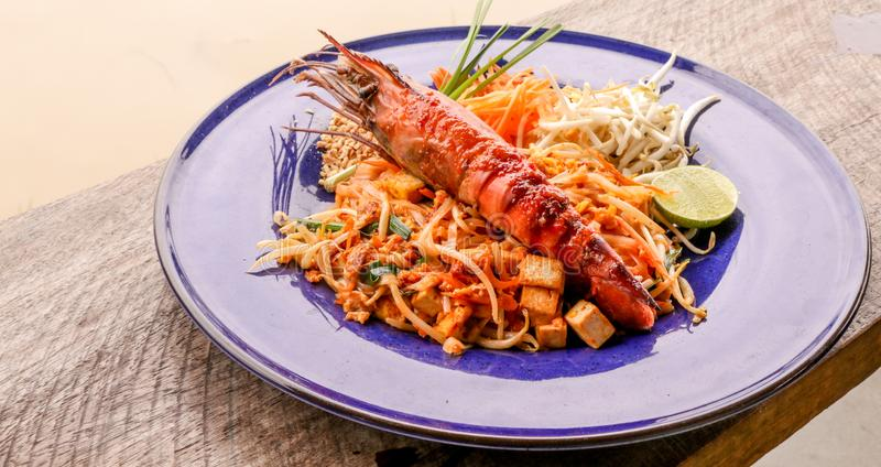 Hot Pad thai with shrimp on wooden table. Pad thai so deliciousclose up royalty free stock photos