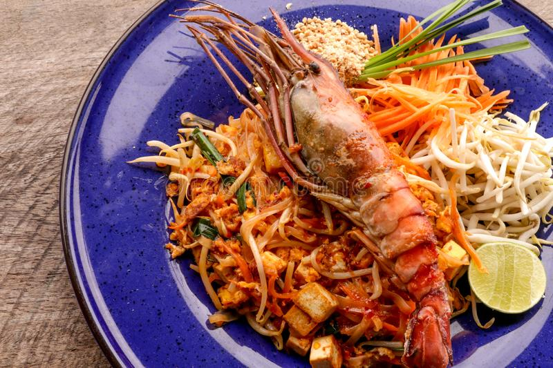 Hot Pad thai with shrimp on wooden table. Pad thai so deliciousclose up stock photo